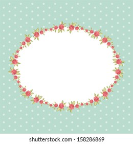 Vintage floral frame with roses in shabby chic style on dots background