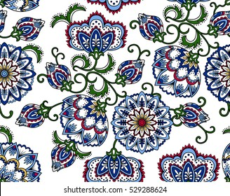 Vintage floral seamless pattern. Ethnic ornament. Stylized decorative flowers in folk style. Traditional handcraft. Seamless texture in blue, green and red colors on white background. Vector
