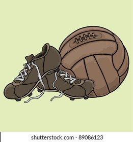 The vintage football boots and ball