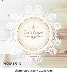 Vintage frame on a realistic wood texture , vector