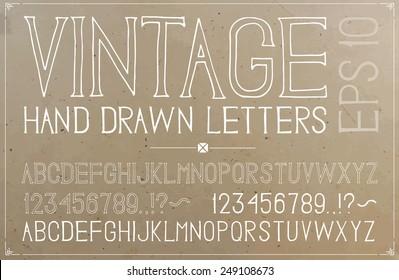 Vintage hand drawn alphabet on plywood background