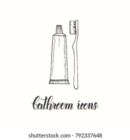 Vintage hand drawn  toothbrush and toothpaste. in a sketch style. Hand made lettering. Vector objects from the bathroom.