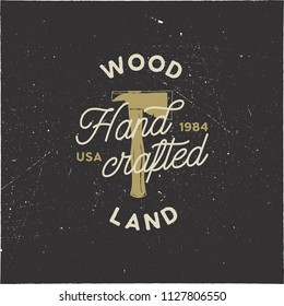 Vintage hand drawn woodworks logo and emblem. Wood land, hand crafted label. Typography lumberjack insignia with crossed axes and texts. Retro silhouette style. Stock vector illusration isolated.