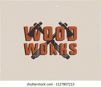 Vintage hand drawn woodworks logo and emblem. Carpentry service label. Typography lumberjack insignia with crossed axes and texts. Retro silhouette style. Stock vector illusration isolated on grunge.