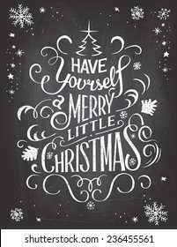 Vintage hand-lettering Christmas greetings on blackboard background with chalk