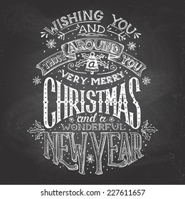 vintage hand lettering christmas and new year wishes with chalk on blackboard background greeting