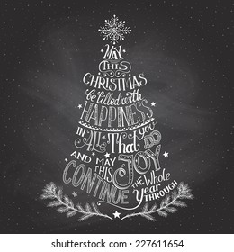 Vintage hand-lettering Christmas tree greeting card with chalk on blackboard background