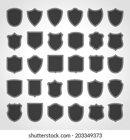 Vintage heraldic shield shapes labels design. Retro style borders, frames, labels set.