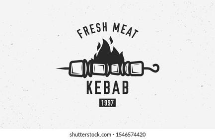 Vintage kebab logo template. Kebab or shashlik on skewer with fire flame isolated on white background. Vector illustration