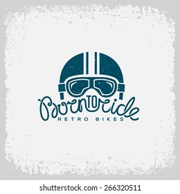 Vintage label with helmet, goggles and lettering text 'Born to Ride' on grunge background for t-shirt print, poster, emblem. Vector illustration.