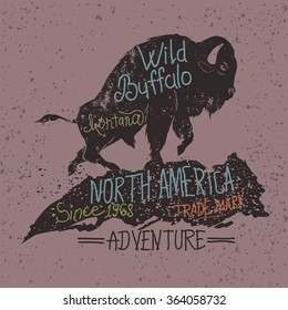 Vintage label of  the wild buffalo.Typography design for t-shirts.Stock vector