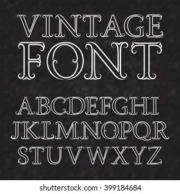 Vintage letters with flourishes. Vintage font in baroque style. Vintage latin alphabet. White outline capital letters on a black textured background.