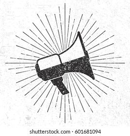 Vintage megaphone with sunburst on grunge background