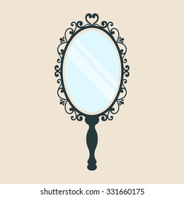 vintage mirror with a handle on a background