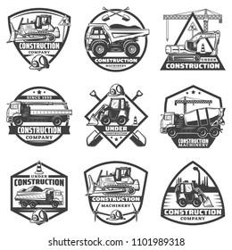 Vintage monochrome construction labels set with inscriptions building equipment trucks crane bulldozer excavator isolated vector illustration