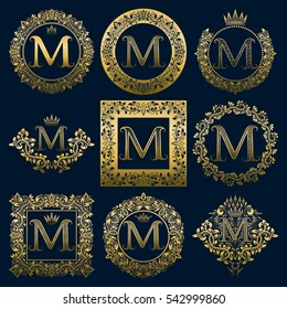 Vintage monograms set of M letter. Golden heraldic logos in wreaths, round and square frames.