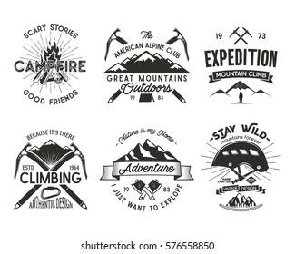 Vintage mountaineering badges set. Climbing logo, vintage vector emblems. Climb alpinism gear - helmet, carabiner, campfire.Retro t shirt design. Old style illustration. Letterpress effect. Isolated.