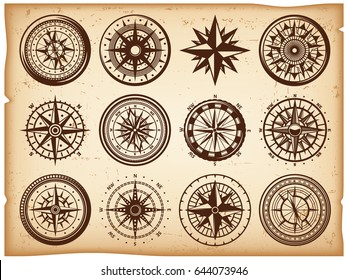 Vintage nautical compasses icons set in different shapes on parchment paper background isolated vector illustration