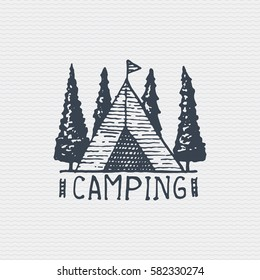 vintage old logo or badge, label engraved and old hand drawn style with camping tent.