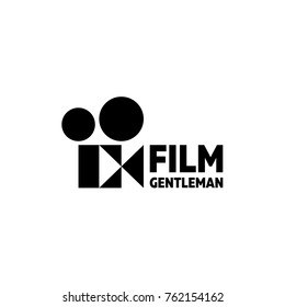 Vintage old Movie Camera with an abstract sign with a built-in butterfly as a gentleman movie, a breezy logo with a double meaning