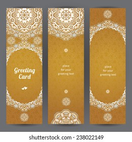 Vintage ornate cards in Eastern style. Golden floral decor with circle ornaments. Template ornamental frame for greeting card and wedding invitation. Filigree vector border and place for your text.