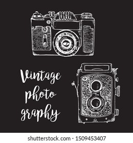 Vintage photo camera vector sketch illustration. Hand draw retro photographer camera white chalk on black board background.