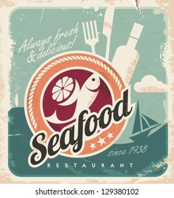 Vintage poster for seafood restaurant. Retro paper background with fish, wine bottle and food. Old fashioned graphic design.