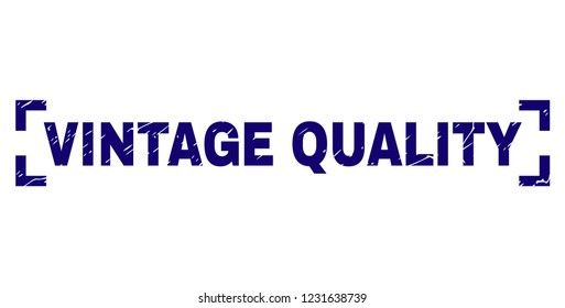 VINTAGE QUALITY caption seal print with distress effect. Text caption is placed inside corners. Blue vector rubber print of VINTAGE QUALITY with dust texture.