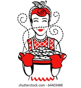 Vintage or retro style mother holding hot, freshly baked cookies for Christmas or the holidays.
