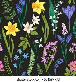 Vintage seamless floral pattern on a black background. Spring flowers and herb. Botanical vector illustration. Engraving. Colorful.