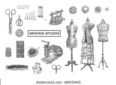 Vintage sewing studio sign with tailor shop stuff. Shears, needle, thread, spool of thread, Sewing Machine, thimble, charcoal iron, sartorial meter, buttons, pin-cushion, tambour, mannequins