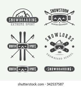 Vintage snowboarding or winter sports logos, badges, emblems and design elements. Vector illustration