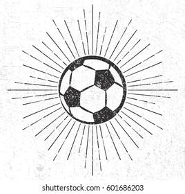 Vintage soccer ball with sunburst on grunge background