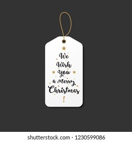 Vintage style christmas tag with we wish you a maerry christmas text. Whtie and gold gift hanger for the holidays.