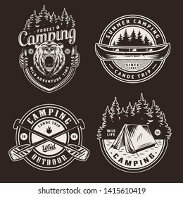 Vintage summer outdoor recreation emblems with ferocious bear head canoe boat forest crossed paddles tent on dark background isolated vector illustration