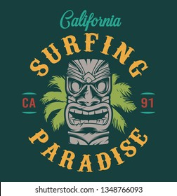 Vintage surfing emblem with traditional hawaiian tribal tiki mask and palm leaves isolated vector illustration