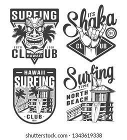 Vintage surfing logos set with tribal tiki mask shaka hand sign surfer house on tropical beach in monochrome style isolated vector illustration