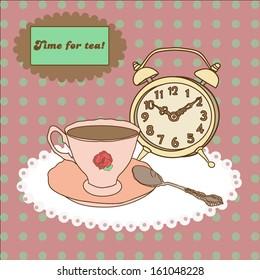 Vintage tea mug, saucer,spoon and alarm clock on tablecloth