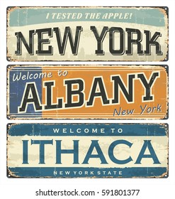Vintage tin sign collection with US cities. New York. Albany. Ithaca. Retro souvenirs or old postcard templates on rust background.