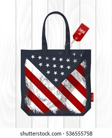 Vintage United States of America flag printed on eco bag. Fabric USA handbag isolated on white wooden background. Premium quality Stars and Stripes burlap shopping bag vector illustration mockup.