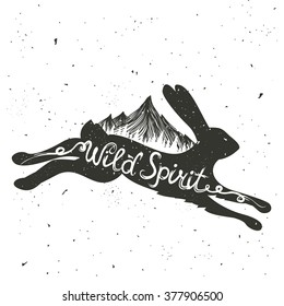 Vintage vector motivational hand drawn style lettering poster. Wild spirit. Typography illustration with hare or rabbit, pine forest and mountains. T-shirt print, home decor, greeting and postal cards
