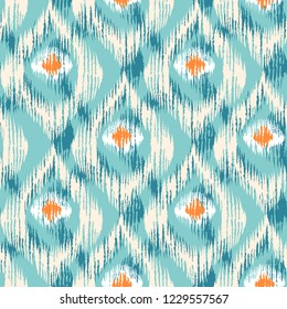 Vintage vector seamless pattern in ikat style. Retro ikat colorful pattern with peacock feathers.