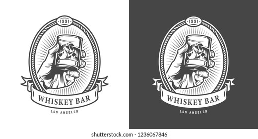 Vintage whiskey bar monochrome emblem with hand holding glass of whisky isolated vector illustration