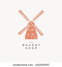 Vintage windmill logo design template for bakery shop. Emblem with a wooden mill. Vector illustration of a village building on a white background.