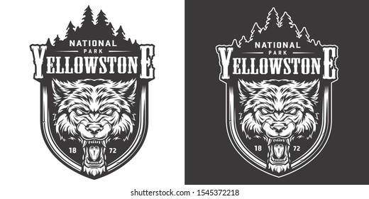 Vintage Yellowstone national park emblem with angry ferocious wolf head and forest landscape isolated vector illustration
