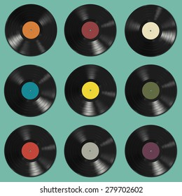 Vinyl records with colorful labels on green background. Seamless pattern.