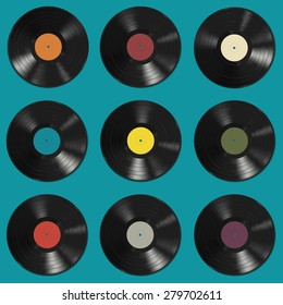 Vinyl records with colorful labels on blue background. Seamless pattern.