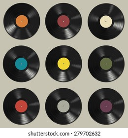 Vinyl records with colorful labels on grey background. Seamless pattern.