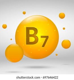 Vitamin B7 gold icon. Biotin drop pill capsule. Vitamin complex design