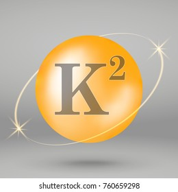 Vitamin K2 gold icon. drop pill capsule. Vitamin complex design